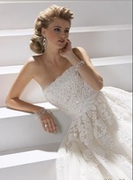 A-line Strapless gown with Appliques/Beads Bow Embellshed Tulle Brush Train White Wedding Dresses